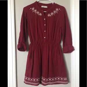 Dark red dress with white embroidery details